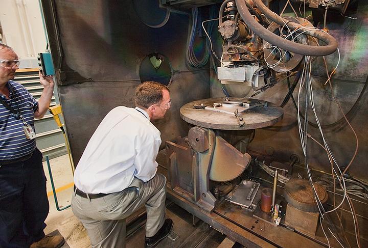 NASA engineers inspecting the early-stage EBF3 system. Photo via NASA.